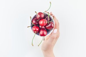 Fresh ripe cherry in a bowl with wom