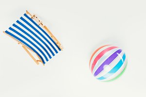 top view of striped beach chair and