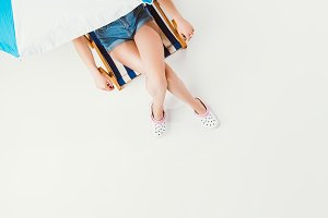 top view of girl sitting on chair un