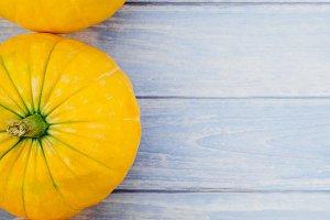 Orange pumpkins on blue wooden backg
