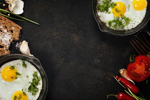 Pans with fried eggs