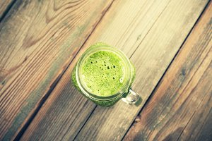 Close up of green fresh smoothie on