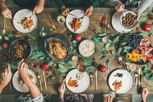 Friends or family eating at festive