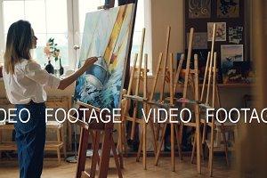 Creative girl is painting beautiful