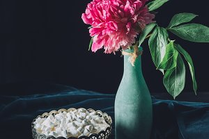 peony flower in vase and vintage bow