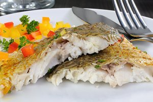 Slices of baked fish Dorado