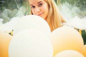 portrait of young girl with balloons