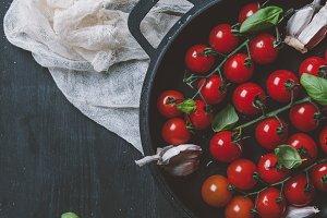 top view of cherry tomatoes, garlic