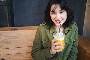 Beautiful woman drinking a fruit smo