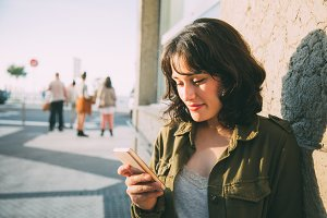 Young woman using her smart phone in