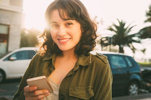 Beautiful woman with a smart phone i
