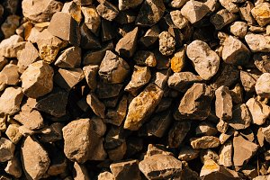 dark crushed stone close up in autum
