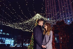 Loving couple at night in Christmas.