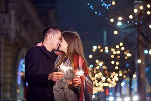 A young couple with sparklers in the