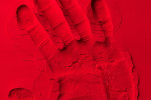 top view of human hand shape on red