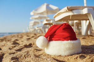 Santa Claus hat on the beach on