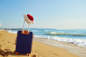 Santa Claus hat on a suitcase on the