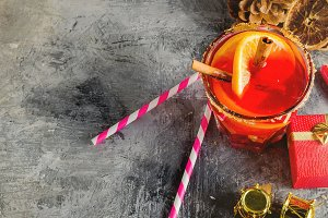 Hot mulled wine drink with orange, a