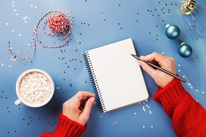 Woman's hand writing in notebook.