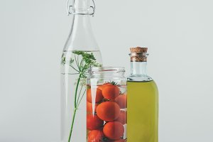 glass jar with tomatoes, glass bottl
