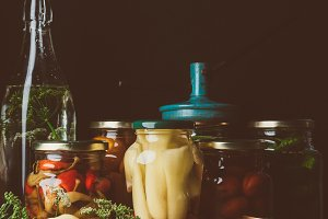 glass jars with preserved vegetables