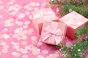 Christmas gifts with pink ribbon