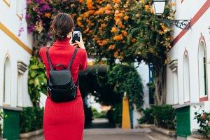 Traveler woman taking a photo