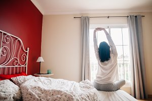 Pretty woman stretching in bed