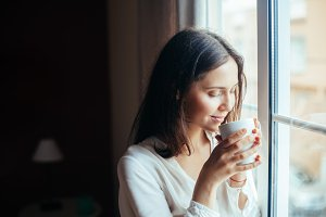 woman drinking hot coffee
