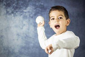 Little making a throw ball of baseba