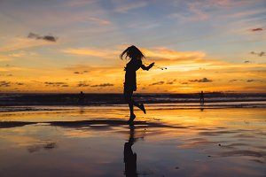 girl on the beach at sunset