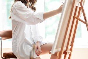 womam painter at artwork process