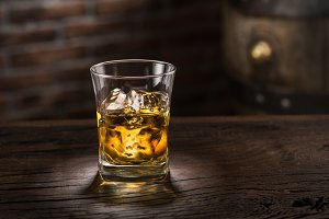 Whiskey glass or glass of whiskey wi