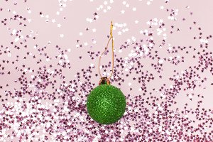 Pink confetti, green christmas balls