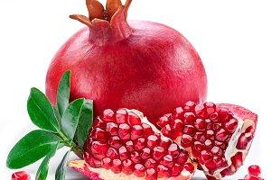 Ripe pomegranate fruits on the white