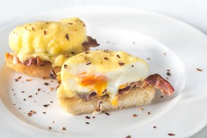 Eggs Benedict on the white plate
