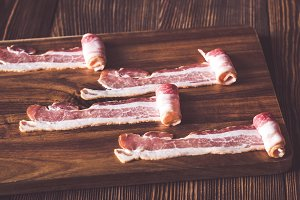 Bacon strips on the wooden board