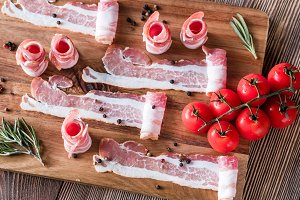 Bacon strips with cherry tomatoes