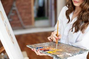 woman painter at artwork process