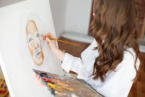 girl painter at artwork process