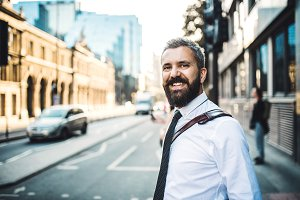 Hipster businessman standing on a