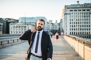 Hipster businessman walking on the