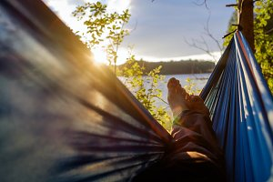Man relaxing in the hammock.