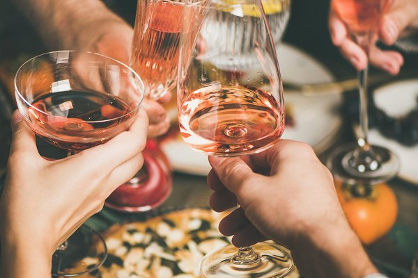 Food Stock Photos - Friends clinking glasses with rose