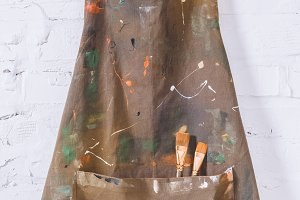artist apron with paint brushes hang