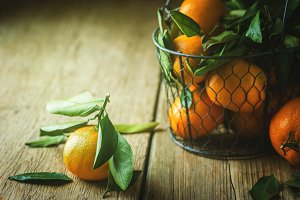 Tangerines with green leaves.