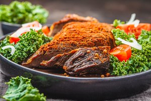 Spicy baked beef with kale salad