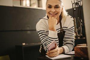 Smiling female jeweler