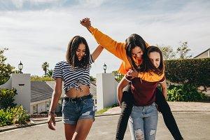 Three girl friends playing