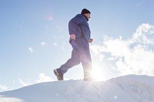 elderly man running in the winter.